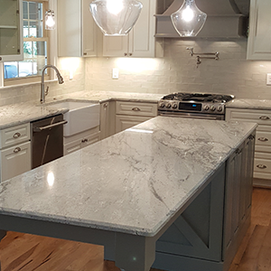 Stone World Granite Counters with Two Tone Cabinets